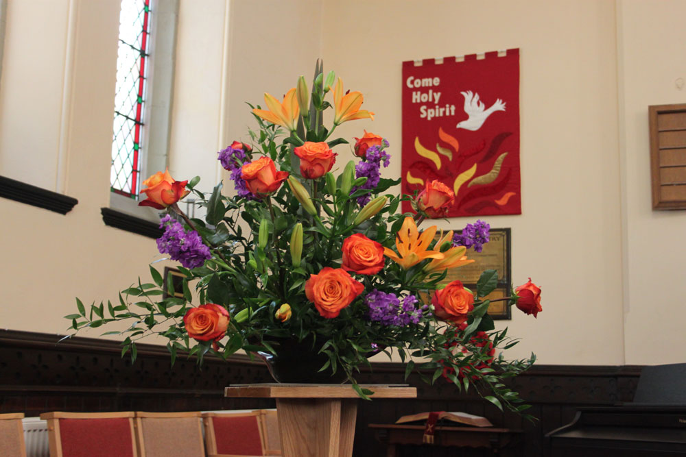church flowers and banner